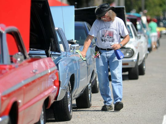 Mike Miers, of Marion, polishes his 1969 Ford Gallaxie XL at last year's Gary Squires Memorial Car Show. Antique and collectible cars, trucks and motorcycles are again expected at this year's show  Saturday on North Main Street in Marion.