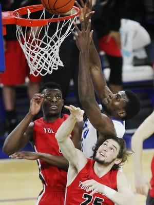 FGCU's Marc-Eddy Norelia scores a basket against Youngstown on Saturday at Alico Arena.
