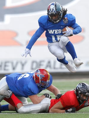 West All Star wide receiver Mondarius Johnson leaps over the line in the first half of the Greater El Paso Football Showcase on Saturday at the Sun Bowl.