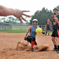 Oconto Falls catcher Virgina Misco, left, throws the ball to home play and teammate Josie Tolzman, right, in an attempt to tag out Southern Door's Erin Tadych during the WIAA Division 2 regional quarterfinal at Southern Door on Tuesday.