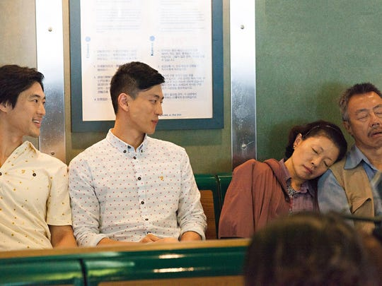 """From L to R: Ning (James Chen) and Ryan (Jake Choi) watch sleeping parents, Yen (Elizabeth Sung) and BA (Ming Lee) in """"Front Cover"""""""