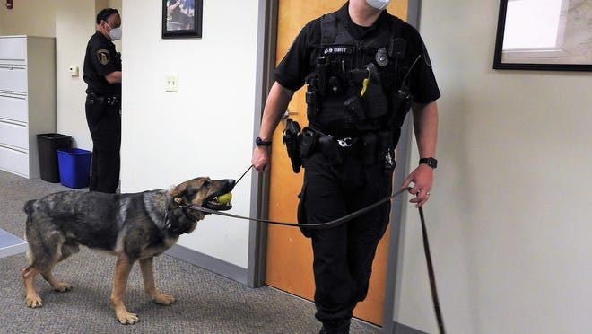 K9 Clyde earned a little time to enjoy his toy during the check presentation from the Kiwanis.