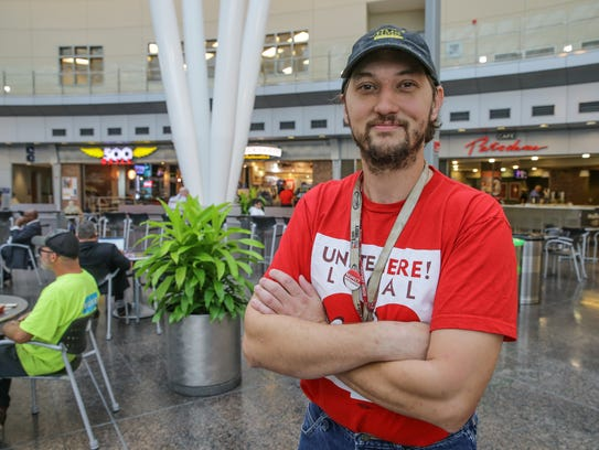 Benjamin Calbert stands in the food court at the Col. H. Weir Cook Terminal at Indianapolis International Airport. He is a cook at the airport.