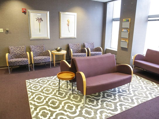 A patient waiting area features soft colors in the