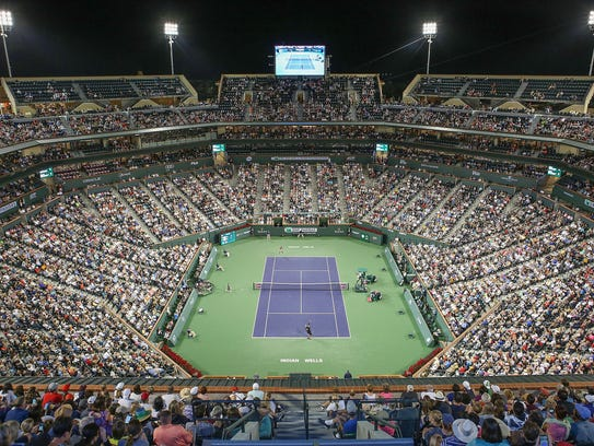 Tennis fans watch Serena Williams play her sister Venus
