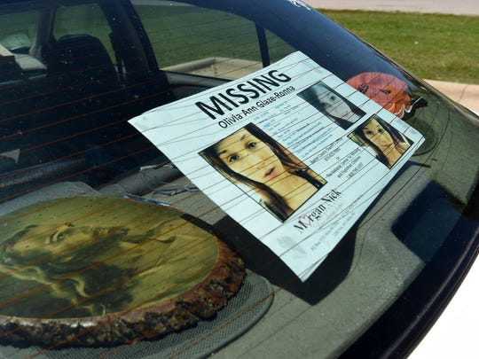 Jason Glaze has a poster of his missing 17-year-old daughter, Olivia Ann Glaze, taped to the back window of his car. Glaze and his fiancée, Janice Landreth, spent Friday distributing the poster throughout the Twin Lakes Area.