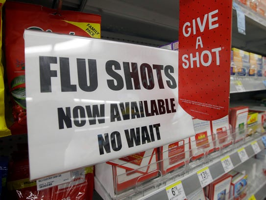 A sign informs customers they can get a flu shot in