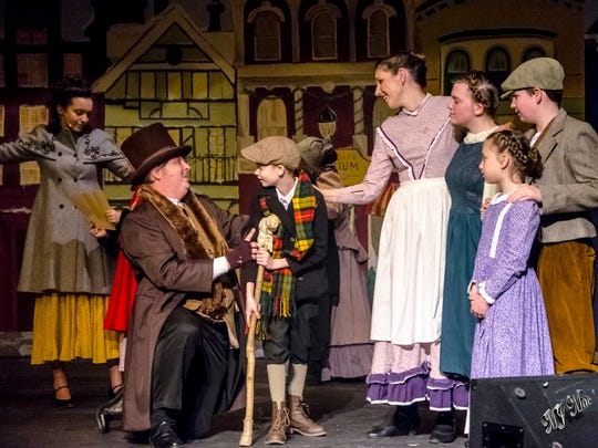 Cast members, from left, Gaea Lawton, Paul Goodman, Carter Weiss, Jenny Torgerson, Cynthia Weaver, Delaney Goodman and Harry Jacob in Wilmington Drama League's 'A Christmas Carol.'
