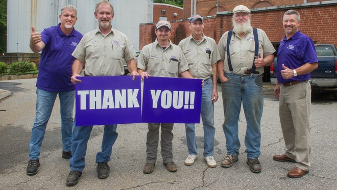 "Workers at Western Carolina University's aging steam plant and some WUC officials posed recently to show their appreciation for inclusion of money to replace the plant in the proposed state budget. Shown from the left are Joe Walker, WCU associate vice chancellor for facilities management; workers Terry Riouff, Darryle Buchanan, Harold Bailey and David ""Dudley"" Burress; and Lee Smith, director of operations and maintenance for WCU's Department of Facilities Management."