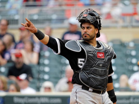 FILE - In this Sunday, May 3, 2015 file photo, Chicago White Sox catcher Geovany Soto gestures to the pitcher during the eighth inning a baseball game against the Minnesota Twins in Minneapolis. Free-agent catcher Geovany Soto and the Los Angeles Angels have agreed to a one-year contract. The team announced the move Tuesday, Nov. 24, 2015, one day after losing catcher Chris Iannetta to the Seattle Mariners in free agency. (AP Photo/Ann Heisenfelt, File)