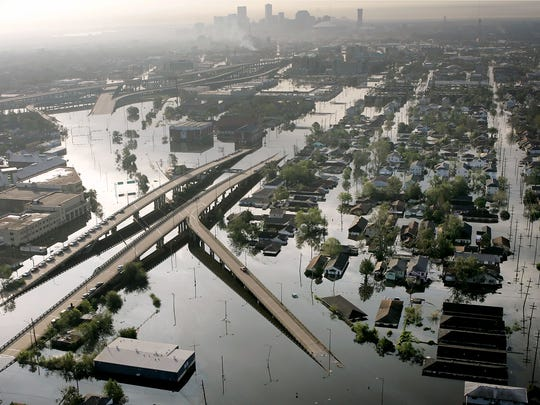 Floodwaters from Hurricane Katrina fill the streets near downtown New Orleans on Aug.30, 2005. Tourism in New Orleans has rebounded in the 10 years since the levees broke, flooding the city.