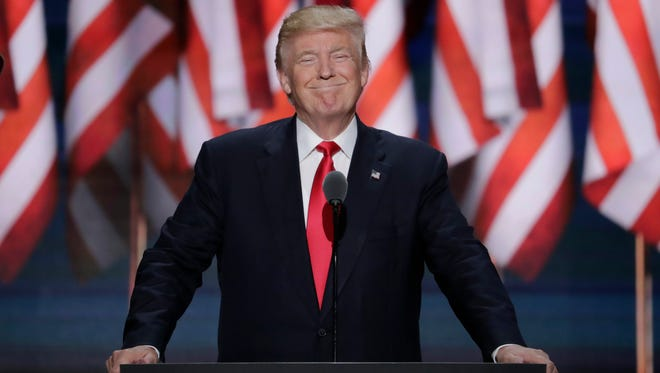 Republican Presidential Candidate Donald J. Trump, smiles as he takes the stage during the final day of the Republican National Convention in Cleveland, Thursday, July 21, 2016.