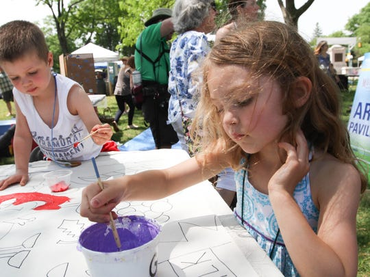 Simone Metzger, 5, along with her brother Marcellas Metzger, 3, take part in painting a mural that will be on display at Whole Foods during Festival Earth, a sustainability fair at the Vail Mansion in Morristown on May 17, 2015.
