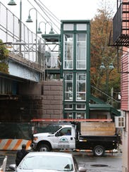 The platform elevator and stairs at the Metro North