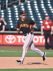 San Francisco Giants second baseman Joe Panik runs the bases during batting practice before a game against the New York Mets at Citi Field on Tuesday.