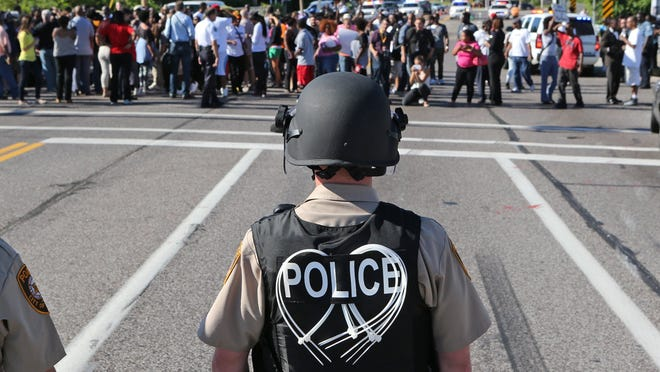Police face off against protesters in Ferguson, Missouri, on Wednesday, as protests continued over the fatal police shooting of Michael Brown, an unarmed black man.