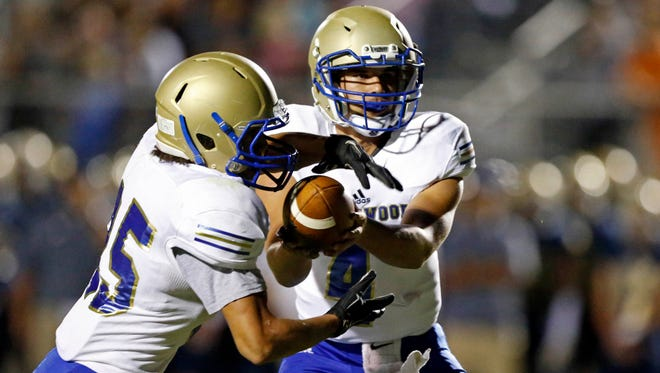 Brentwood quarterback Carson Shacklett (4) hands the ball off during their game against Independence, Friday, Sept. 29, 2017, in Nashville, Tenn. (Photo by Wade Payne, Special to the Tennessean)