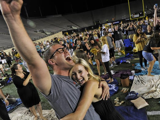 Vanderbilt fans celebrate after their baseball team defeats Virginia in the College World Series during a watch party at Dudley Field Wednesday June 25, 2014, in Nashville, Tenn.