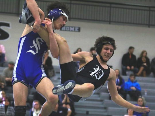 Cam Shaughnessy of Salem (left) takes down Plymouth's