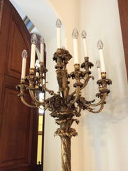 This hand-tooled brass candelabrum  donated by Pat and Joe Perin stands outside the chapel at Summit Country Day School.