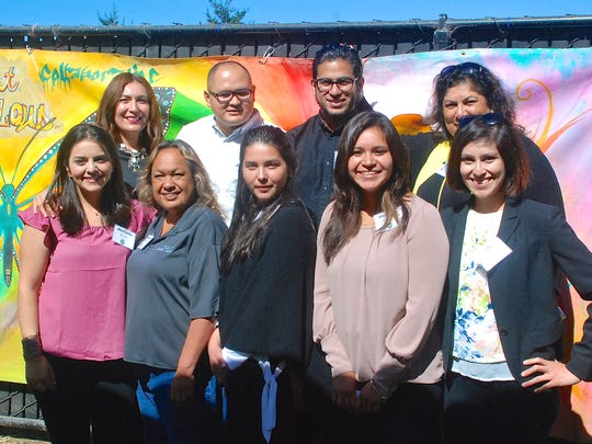 The staff of the new Alisal Family Resource Center are (front row from left): Ana Nava, Pauline Rosas, Isabel Nieto and Janet Martinez-Angeles. Back row from left: Margarita Camacho, Julio Hernandez, Max Estrada and Maria Garibay.