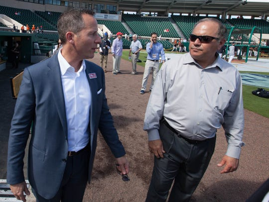 Tigers owner Chris Ilitch, left, and general manager