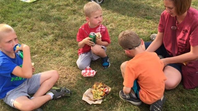 Donita Farnsworth enjoys a picnic with (from left) nephew Edward Henry and sons Lucas and Costner.