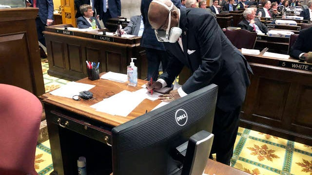 """In this March 19 file photo State Rep. G.A. Hardaway, D-Memphis, wears a mask during House floor proceedings in Nashville, Tenn., amid the coronavirus pandemic. Sharing information about people who have tested positive or been exposed to COVID-19 with first responders does not violate medical privacy laws, under guidance issued by the U.S. Department of Health and Human Services. That has not quelled skepticism about how the data is used. """"Tell us how it's working for you, then tell us how well it's been working; don't just tell us you need it for your job,"""" said Hardway, a Memphis Democrat who chairs the Tennessee Black Caucus."""