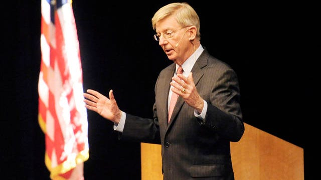 """In this Nov. 4, 2015 file photo, political columnist George Will answers audience questions during a meeting of The Economic Club of Southwestern Michigan at Lake Michigan College, in Benton Township, Mich. Will has been pondering the meaning of the shortest Major League Baseball season since 1878. """"If you're an Indians fan and you win the World Series, are you elated or do you think this is just one more insult?"""" he said."""