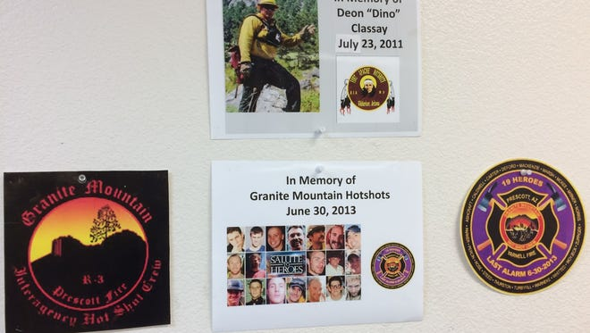 Posters at a firefighting station in Whiteriver, Ariz., in memory of fallen firefighters including the Granite Mountain Hotshots.
