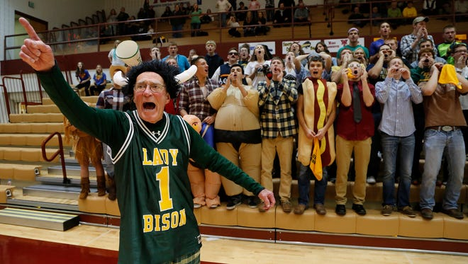 Dick Atha leads the Benton Central students in a cheer during the championship of the J&C Hoops Classic Saturday, November 22, 2014, at McCutcheon High School. Benton Central defeated host McCutcheon 44-34 to win the J&C Hoops Classic championship.