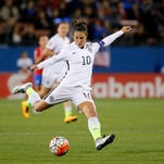 United States' Carli Lloyd takes a shot at the Costa Rica net during a CONCACAF Olympic qualifying tournament soccer match Wednesday, Feb. 10, 2016, in Frisco, Texas. (AP Photo/Tony Gutierrez)