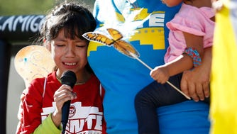 FILE - In this Monday, June 18, 2018 file photo, Akemi Vargas, 8, cries as she talks about being separated from her father during an immigration family separation protest in front of the Sandra Day O'Connor U.S. District Court building in Phoenix. Child welfare agencies across America make wrenching decisions every day to separate children from their parents. But those agencies have ways of minimizing the trauma that aren't being employed by the Trump administration at the Mexican border.