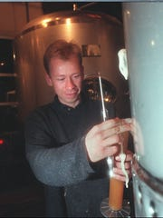 Brewmaster Dave Hartmann checks the gravity level in the Empire Brewing Company's Hefe-Weizen Yeast Wheat in the brewing room in January 1997.