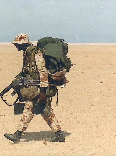 "A soldier in Command Sgt. Maj. Robert Nichols' brigade during the Gulf War in 1991. ""That's everything that kid had,""Nichols said. ""You can tell he's an assistant gunner by looking at him."""