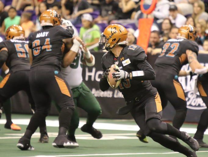 Rattlers quarterback Jeff Ziemba looks to pass during
