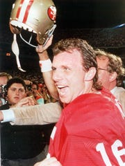 Joe Montana celebrates after beating the Bengals in