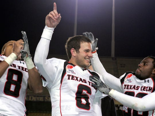 Texas Tech quarterback Graham Harrell (6) celebrates with teammates Joel Filani (8) and Antonio Huffman, right, after Texas Tech defeated Minnesota in the Insight Bowl, 44-41 in overtime, Dec. 29, 2006.