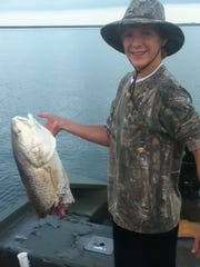 Caden Comer, 15, of Bay St. Louis was fishing in the Pearl River with Dave Harville of Waveland when what is suspected to be a bull shark sheared a 25 pound redfish in half.