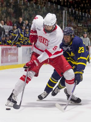 Cornell senior Christian Hilbrich handles the puck during the second period of Cornell's 5-2 win over Merrimack Saturday at Lynah Rink on January 9, 2016.