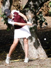 Oaks Christian's Holly Johnson hits her ball across a small pond on the 18th fairway Monday at Los Robles Greens Golf Course during the CIF-SS Northern Divison Team Championship Tournament.