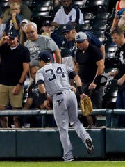New York Yankees' Dustin Fowler tries to walk after suffering an injury during the first inning of the team's baseball game against the Chicago White Sox on Thursday, June 29, 2017, in Chicago.