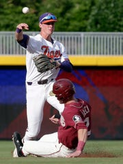 Clemson shortstop Logan Davidson throws to first base as Florida State's Jackson Lueck (2) is forced out at second base during the first inning of an NCAA college baseball game in the semifinals of the Atlantic Coast Conference tournament in Durham, N.C., Saturday, May 26, 2018. (AP Photo/Gerry Broome)