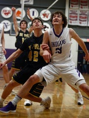 Southeast Polk freshman Jaxon Dailey and Indianola senior Matt Deike fight for position to rebound a free throw. Southeast Polk stunned Indianola 67-64 in a Class 4A substate quarterfinal in Indianola on Feb. 18.