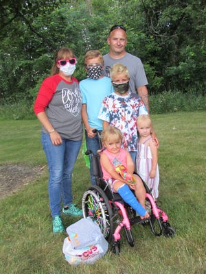 One of the families part of A Kid Again is the Taggart family in Jewett. They include front, Annie, 6; second row, mother Sara, Troy, 11, Ty, 9, and April, 2; and back, father Adam.