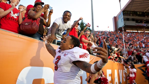 Aug 31, 2013; Corvallis, OR, USA; Eastern Washington Eagles quarterback Vernon Adams (3) celebrates with fans after defeating the Oregon State Beavers  49-46 at Reser Stadium. Mandatory Credit: Jaime Valdez-USA TODAY Sports