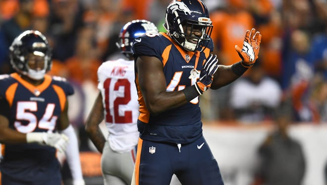Denver Broncos outside linebacker Shaquil Barrett (48) celebrates after a sack last season.