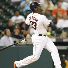 HOUSTON, TX - AUGUST 26:  Chris Carter #23 of the Houston Astros hits a three-run home run in the eighth inning against the Oakland Athletics at Minute Maid Park on August 26, 2014 in Houston, Texas.  (Photo by Bob Levey/Getty Images)