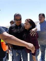 Family and friends gather along Navajo Route 13 south