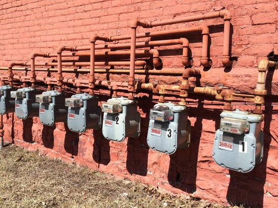 Tax on heat? A row of natural gas meters line a wall